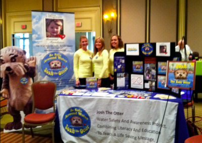 JCMF Co-Founder Kathy Collingsworth, Art Director Ashley Spitsnogle, and Projects Manager Laura Thomas at 2011 Rotary International Zone 33-34 Institute (Washington, D.C.