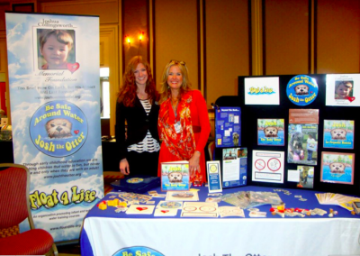 JCMF Co-Founder Kathy Collingsworth and Art Director Ashley Spitsnogle at Josh the Otter booth at 2011 Zone 33-34 Institute in DC.